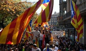Protesters display pro-independence flags in Barcelona on Wednesday.
