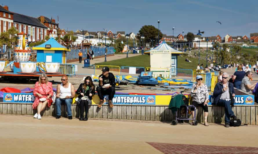 People enjoy the sunshine on the beach in Barry Island as the election campaign gathers pace.
