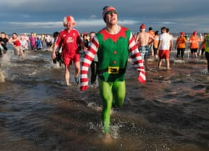 Hundreds of people race into the cold waters of the North Sea at Redcar