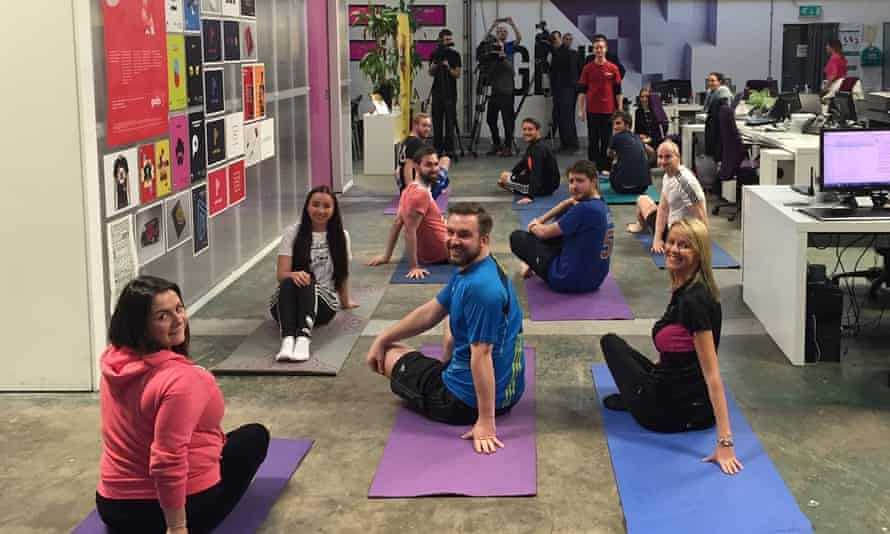 People in office doing yoga