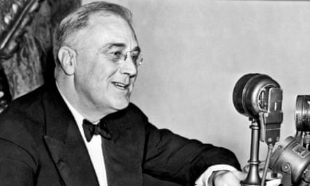 President Franklin D Roosevelt, seated behind microphone, Washington DC, 1937.