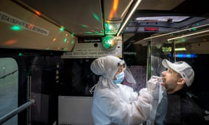 People are being PCR tested in Partybus in Ishoej, Denmark. While the citizens are being tested, they can listen to music and watch disco lights.