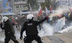 Riot police fire tear gas canisters toward protesters during a demonstration in Warsaw on Saturday.