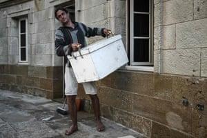 Dalisson carries a box