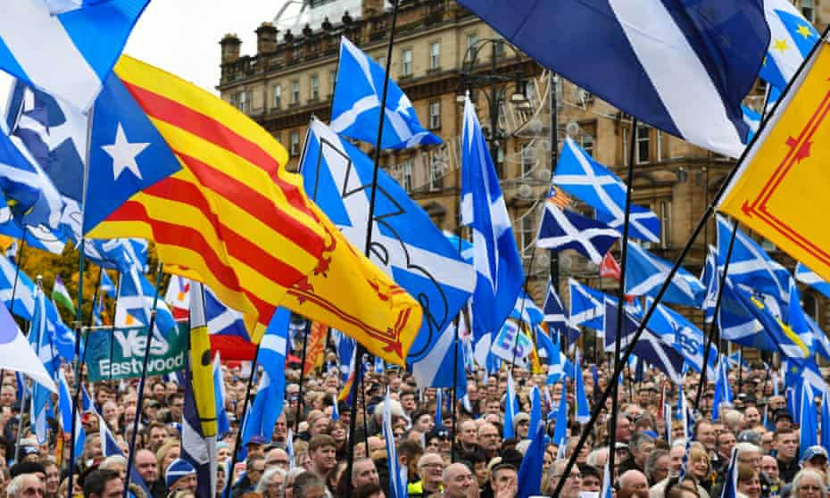 Yes flags being waved during a rally