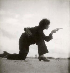 Barcelona, Spain, August 1936. A Republican militia fighter training on a beach