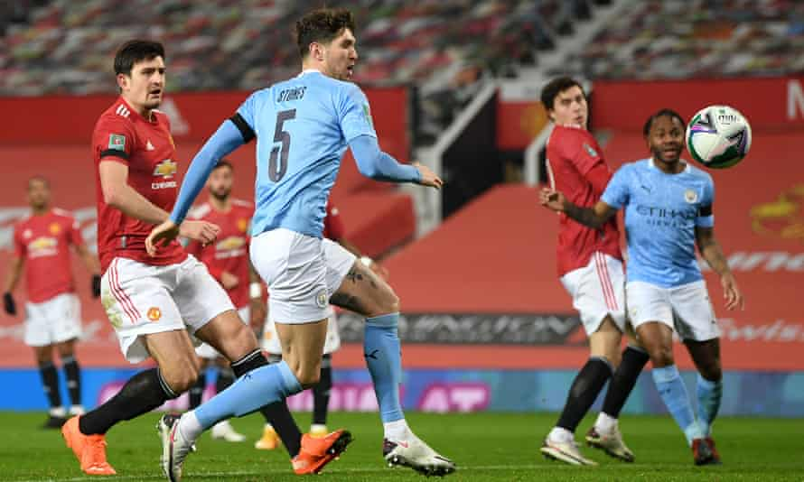 John Stones scores the opening goal for Manchester City at Old Trafford.