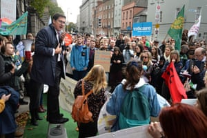 Irish Green Party leader Eamon Ryan addresses a climate change demonstration outside Irish government buildings on 16 October 2018
