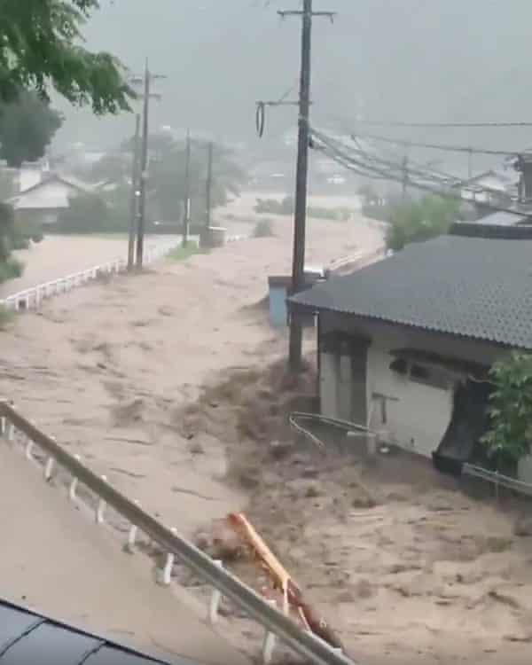 Muddy water flows through a residential area after unprecedented torrential rains inKumamoto Prefecture.