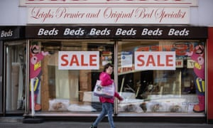 Local Authority Budgets Wigan<br>© Joel Goodman for the Guardian - 07973 332324 - all rights reserved . 22/10/2018 . Leigh , UK . A woman walks past a bed shop on Railway Road . Local authorities are adopting different approaches to manage cuts in funding after years of austerity . Photo credit : Joel Goodman