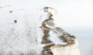 Walkers on a snow-covered Beachy Head near Eastbourne