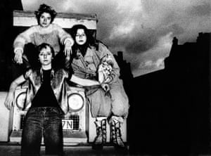 British punk band the Slits pose on a Land Rover in Camden, north London, in 1977