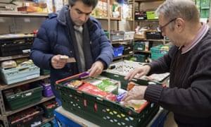 Foodbank volunteers sort through donations in Stalybridge