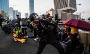 A pro-democracy protester throws a molotov cocktail outside the government headquarters in Hong Kong.