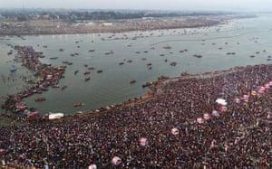 Sangam, India: Thousands of Hindu pilgrims take a dip during the Kumbh Mela