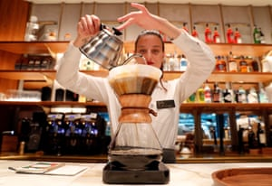 An employee prepares a coffee inside the new Starbucks Reserve Roastery flagship shop in Milan, Italy