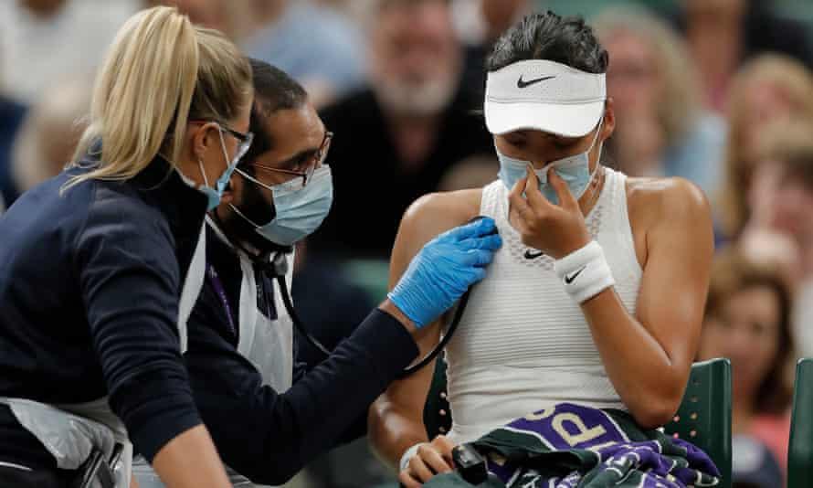 Britain's Emma Raducanu receive medical attention during the women's singles fourth-round match against Australia's Ajla Tomljanovic.