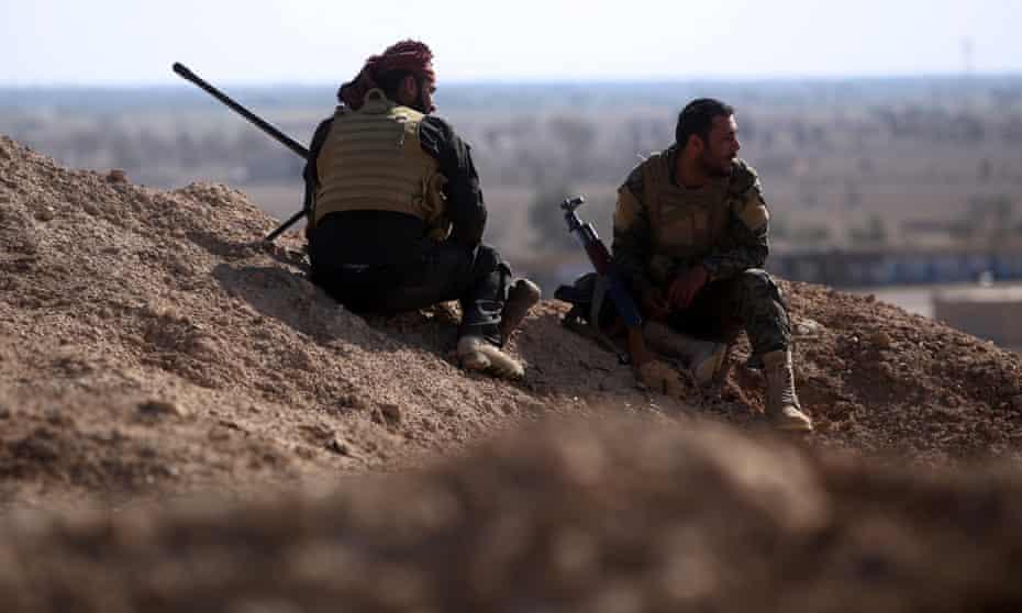 Members of a pro-government militia in Garma, Iraq