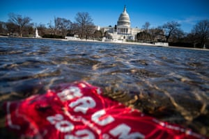 A Donald Trump campaign poster stands underwater in the Capitol Reflecting Pool near the west front of the United States Capitol on Saturday.