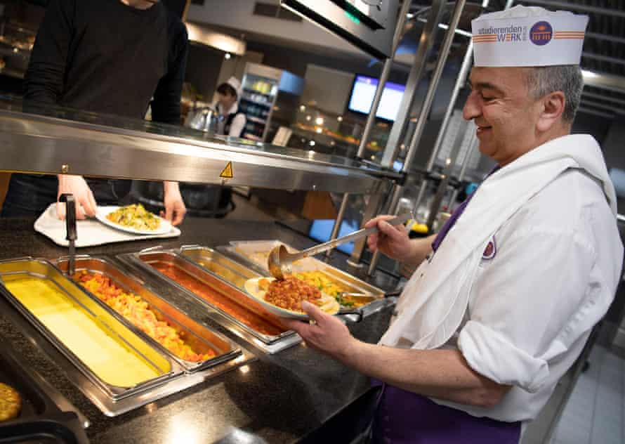 Niko Tortonitis, cook, serves a vegan dish with noodles and soy Bolognese in the vegan refectory.