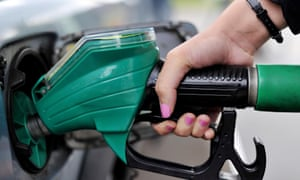 A person using a petrol pump.