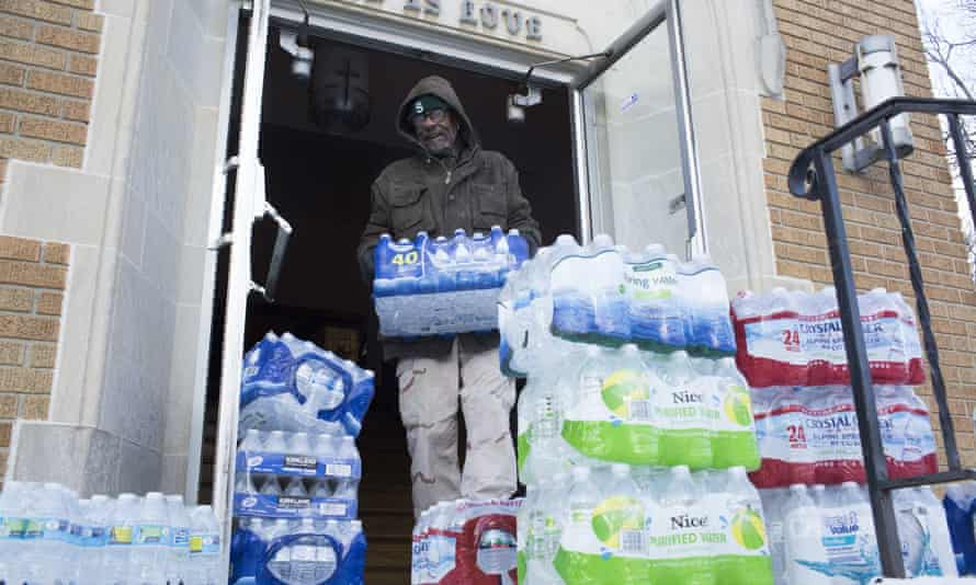 Maurice Rice organizes cases of water at the Joy Tabernacle church in January in Flint.