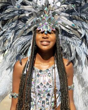 A masquerade dancer enjoying the sun