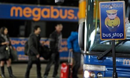People board a Megabus in Washington DC.