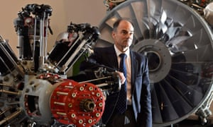 Warren East, CEO of Rolls-Royce, beside aeroplane engines at the company's Bristol site.
