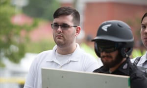 James Alex Fields Jr is seen participating in the 'Unite the Right' rally before his arrest in Charlottesville.