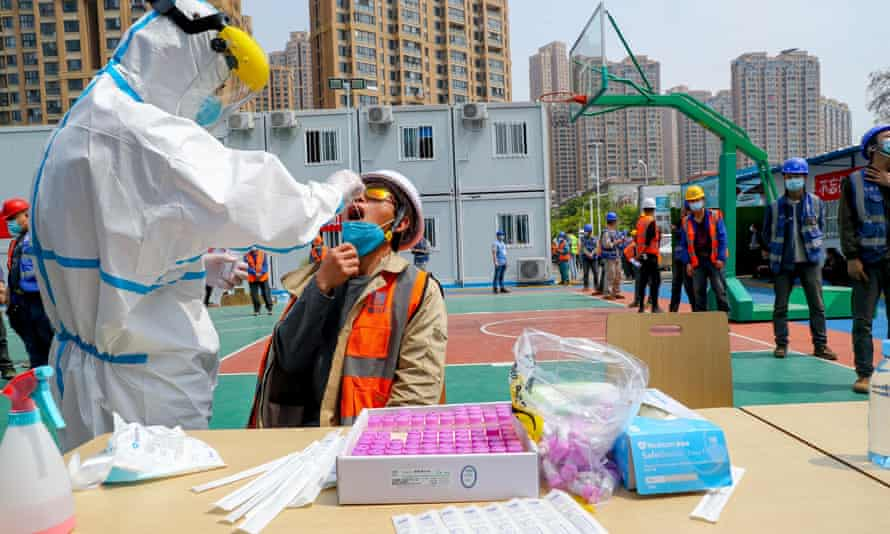 Construction workers are tested for coronavirus in Wuhan, China, 7 April 2020
