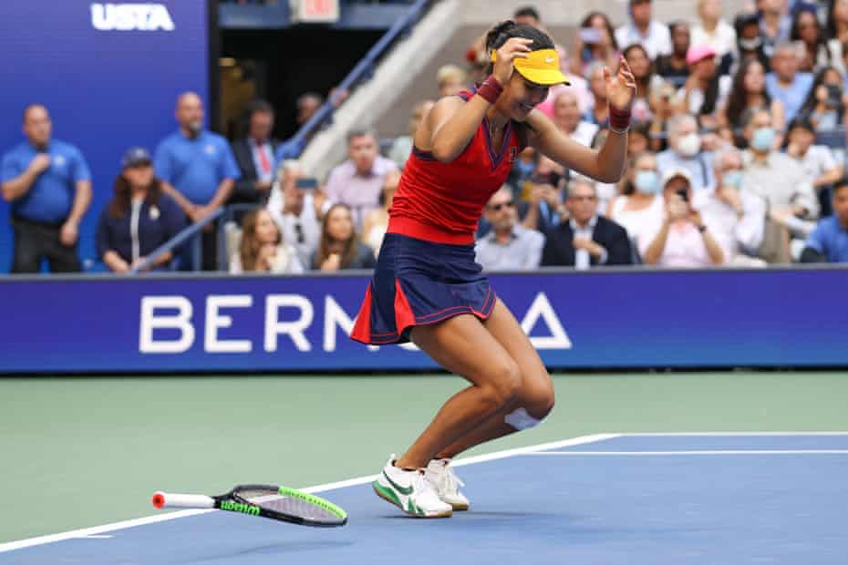 Emma Raducanu drops to the floor in delight after winning the US Open without dropping a set.