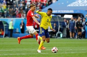 Michael Lang pushes Sweden's Martin Olsson.