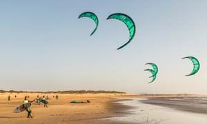 kitesurfers on beach in Morocco