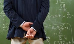 A teacher in front of a blackboard.