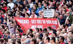 Arsenal fans hold up anti-Stan Kroenke banners during the match against Everton at the Emirates on Sunday.