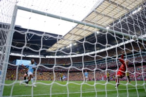 Manchester City's Raheem Sterling fires the ball into the roof of the net for City's fifth goal.