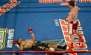 Down but not out: Amir Khan lies on the canvas in Las Vegas on Saturday night but says he will return to the ring, and hopes to by the end of the year.
