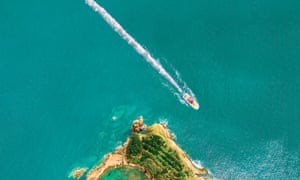 a boat passing the Azores islet of Vila Franca do Campo, with a line of cocaine as its wake