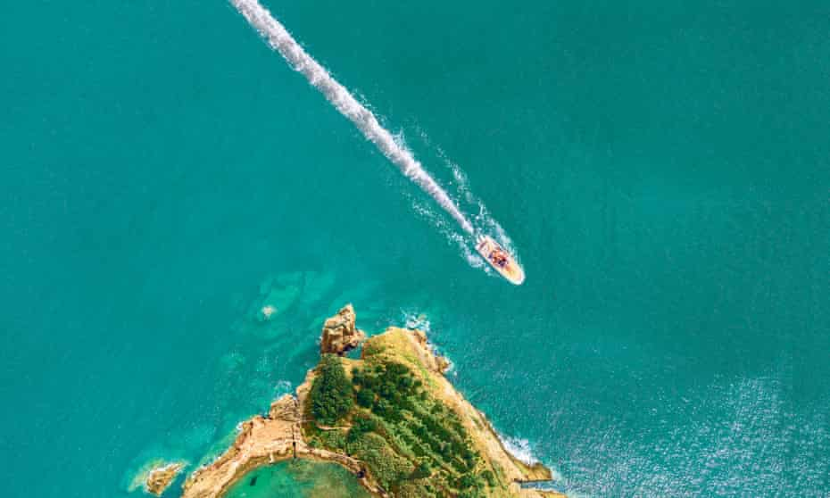 composite: boat with wake like line of cocaine next to Islet of Vila Franca do Campo near San Miguel, Azores