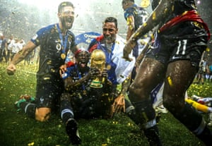 A sudden downpour made for some fantastic photos as France collected the trophy – including Benjamin Mendy sliding along the turf at Luzhniki Stadium.