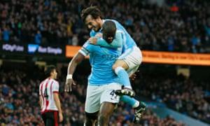 Yaya Touré celebrates with David Silva after scoring Manchester City's second goal against Sunderland in December 2015.