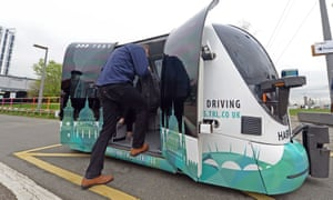 A passenger hops into Harry, the driverless pod being trialled in Greenwich, south-east London