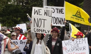 Protesters rally at the Capitol building in Sacramento on 20 April to demand that Governor Gavin Newsom ease coronavirus restrictions.