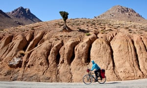Cyclist en route to Telouet, Ounila Valley, Morocco