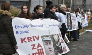 People, including victims, protest in front of the international criminal tribunal for the former Yugoslavia (ICTY) prior to the verdict