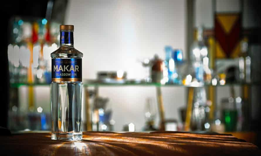 Glasgow Distillery's Makar gin, a bottle of which is in the foreground. In the background are shelves with more bottles of gin.