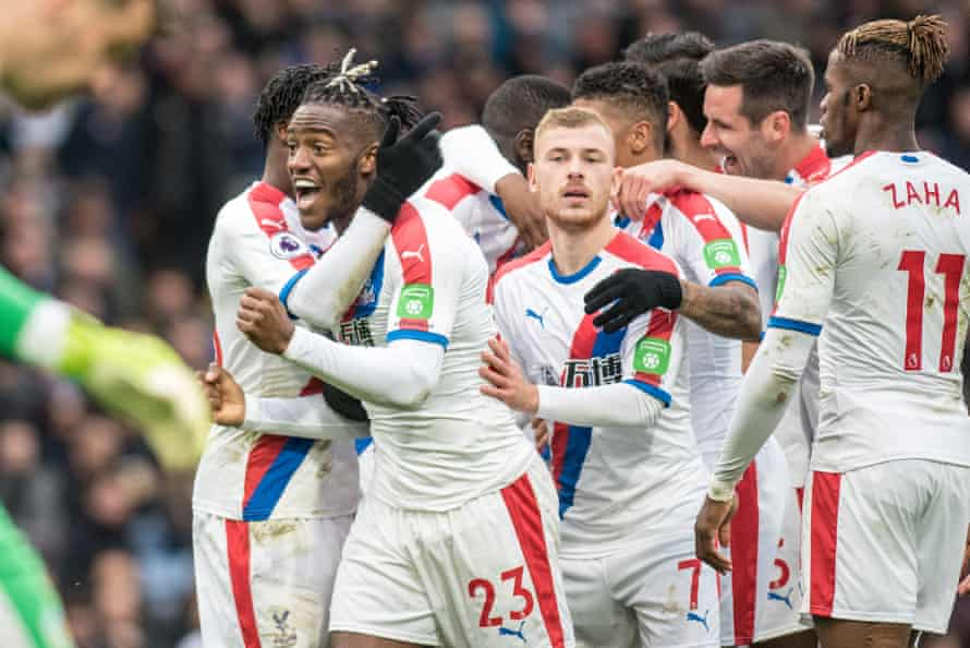 Michy Batshuayi and Palace celebrate their second goal.