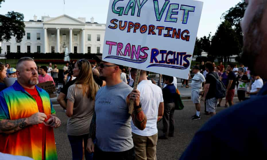 Demonstrators protest Donald Trump's ban on transgender people in the military.