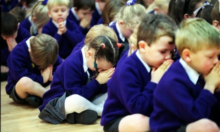 Children praying in assembly